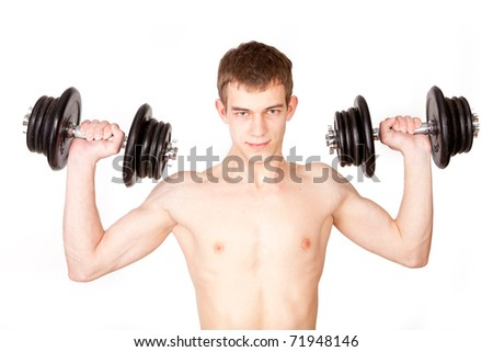 Young body builder lifting weights