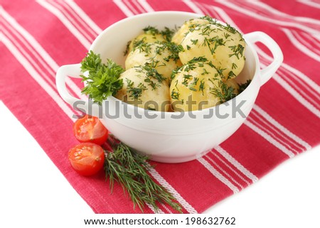 Young boiled potatoes in bowl, close up