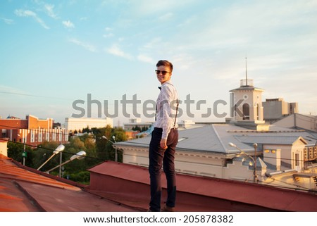 Young bold girl woman hipster, walking on roof and smiling - stock photo