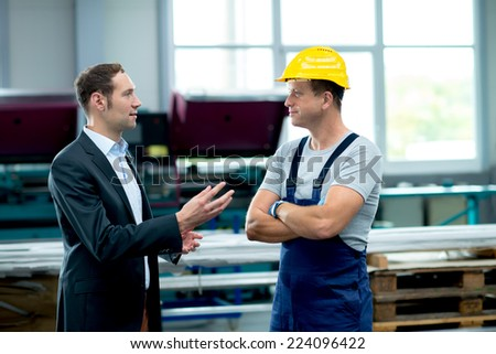 young boss and worker in conversation - stock photo