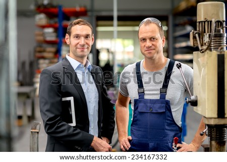 young boss and worker together - stock photo