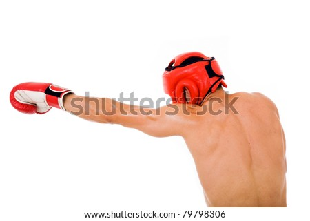 Young Boxer fighter with boxing helmet and gloves making a punch over white background - stock photo