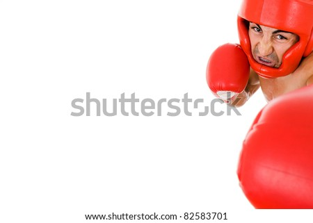 Young Boxer fighter with boxing helmet and gloves making a punch over white background