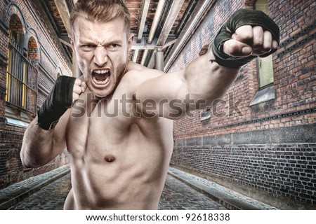 Young boxer in front of urban style - stock photo