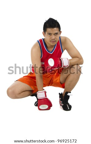 Young boxer sitting while poses in ready to fight. - stock photo