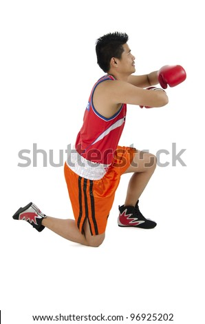 Young boxer styling in muay thai boxing. - stock photo