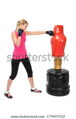 Young Boxing Lady with Body Opponent Bag, Adjustable Practice Mannequin - stock photo