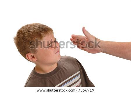 Young boy about to be slapped in the face - stock photo