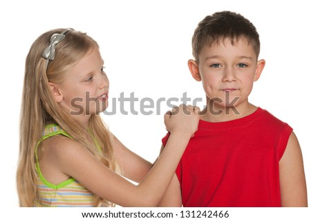 Young  boy and  girl are standing together on the white background