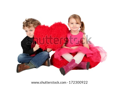 Young boy and girl holding a valentine heart - stock photo
