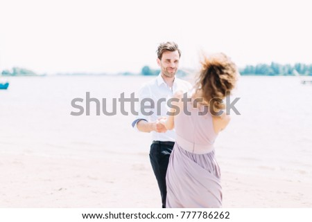 young boy and girl rest on the beach