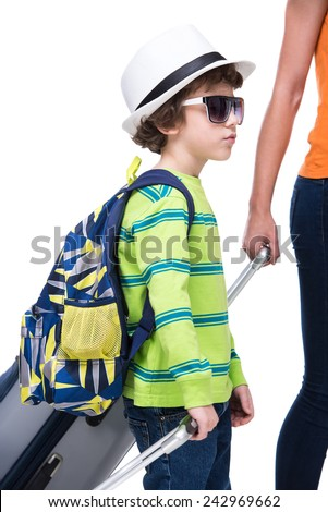 Young boy and his mother with suitcases before travel, isolated on white background. - stock photo