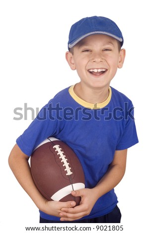 Young boy and rugby ball isolated on white background - stock photo