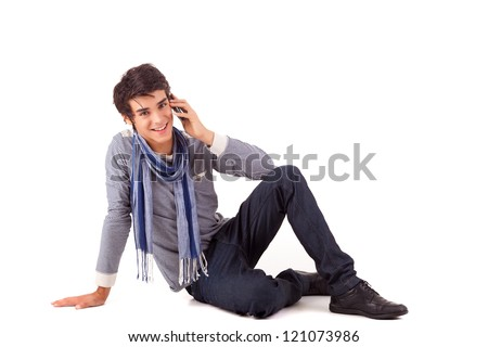 Young boy at the phone, isolated over white - stock photo