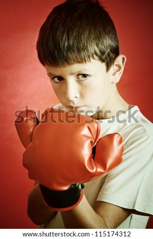 Young Boy Boxer with red Boxing Gloves - stock photo