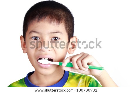 young boy brush their teeth on the morning - stock photo