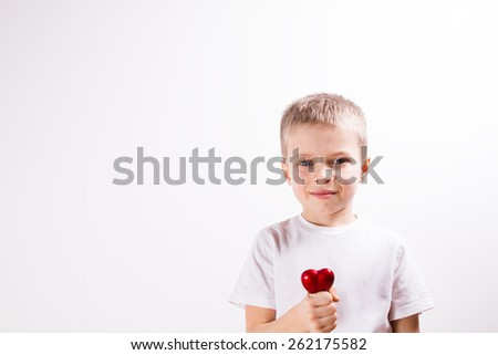 Young boy brushing his teeth - stock photo