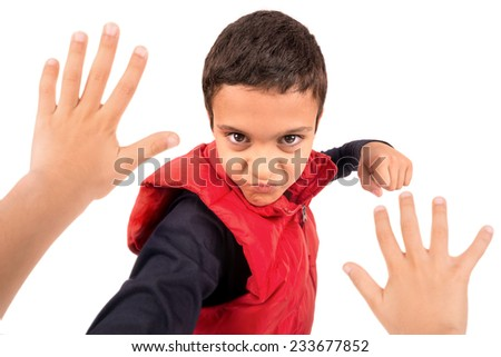 Young boy bullying another isolated in white - stock photo