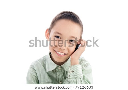 young boy calling on the cellphone isolated on white - stock photo