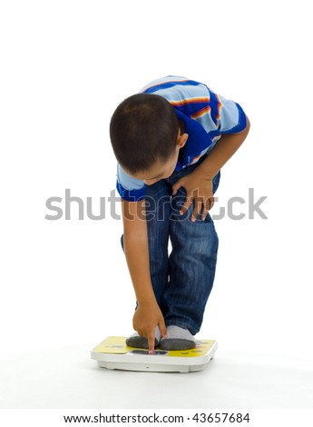 young boy checking his weight, isolated on white - stock photo