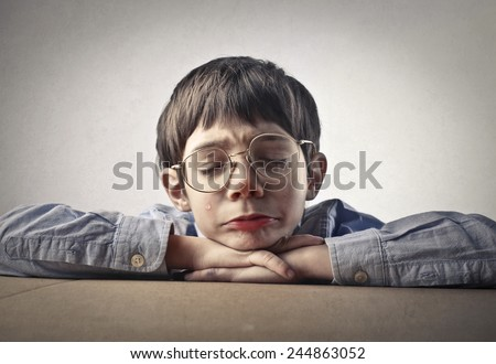 Young boy crying  - stock photo