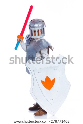 Young boy dressed as a Knight isolated on white - stock photo