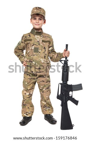 Young boy dressed like a soldier with rifle isolated on white - stock photo