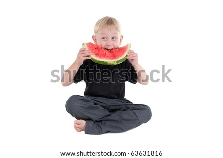 Young Boy eating a watermelon eagerly - stock photo