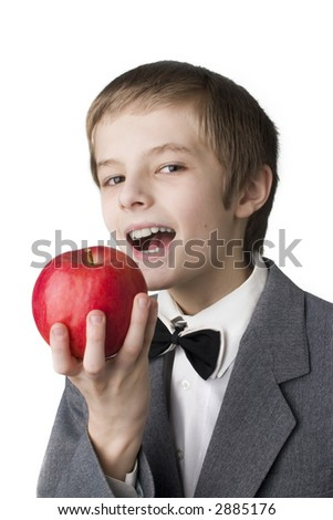 young boy eating big red apple - stock photo