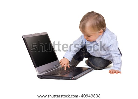 Young boy (eighteen months) with laptop