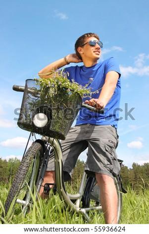 Young boy enjoying nature riding a bike - stock photo