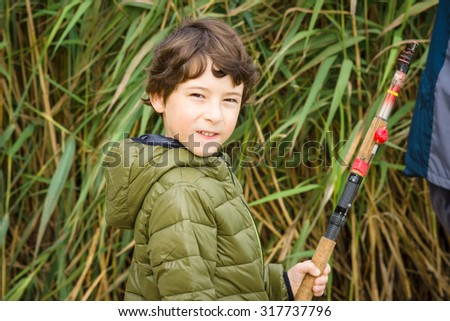 Young boy fishing. - stock photo