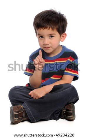 Young boy gesturing number one isolated over white background