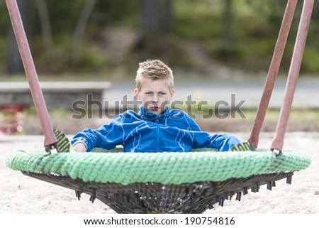 Young boy having fun at a playground.