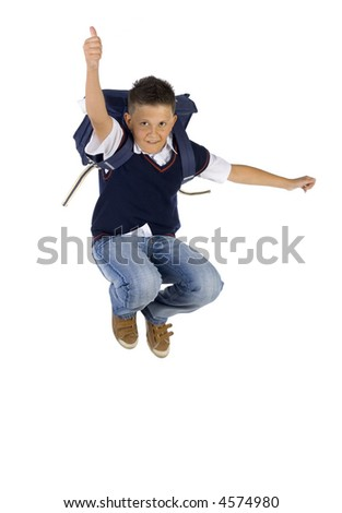 Young boy having fun. Jumping in the air with backpack. Looking at camera. Thumb up. Isolated on white in studio - stock photo