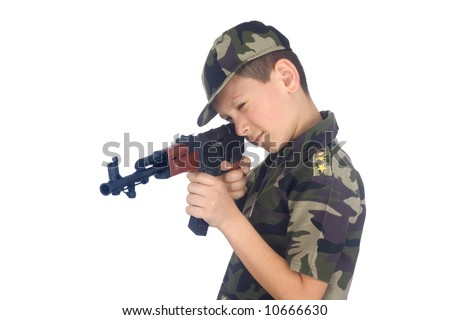 Young boy hold gun isolated on white background - stock photo