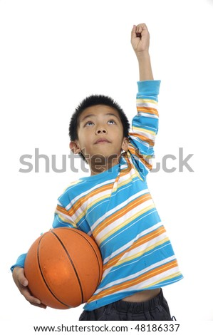 Young boy holding a Basketball - stock photo
