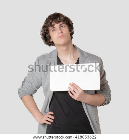 young boy holding a sign - stock photo