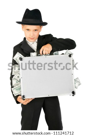 young boy holding a suitcase with money on a white background - stock photo