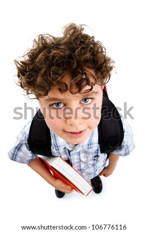Young boy holding books on white background - stock photo