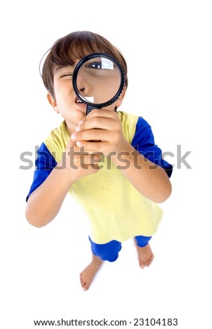 Young boy holding magnifying glass . - stock photo