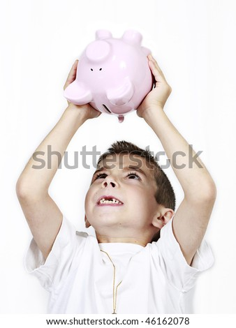 Young boy holding up Piggy Bank isolated on white