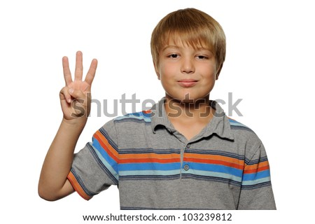 Young boy holding up three fingers.