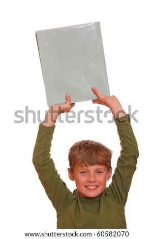 Young boy holds a book - copyspace