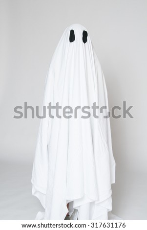 young boy in a homemade ghost costume ready for halloween - stock photo