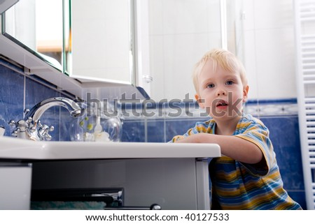 young boy in bathroom