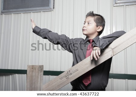 Young boy in business attire waving - stock photo