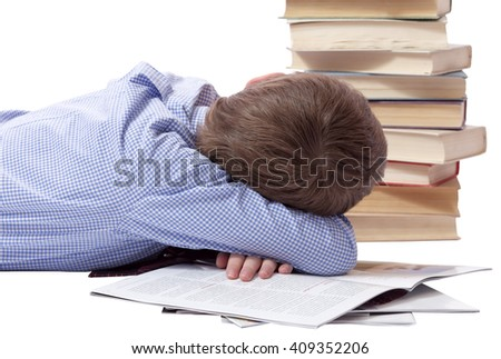 Young boy in classic  dress sleeping with heap of books - stock photo