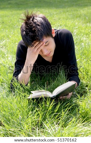 young boy in nature stressed - stock photo