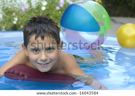 Young boy in pool - stock photo
